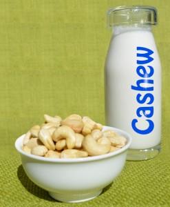 cashew nut milk with a bowl of raw cashews