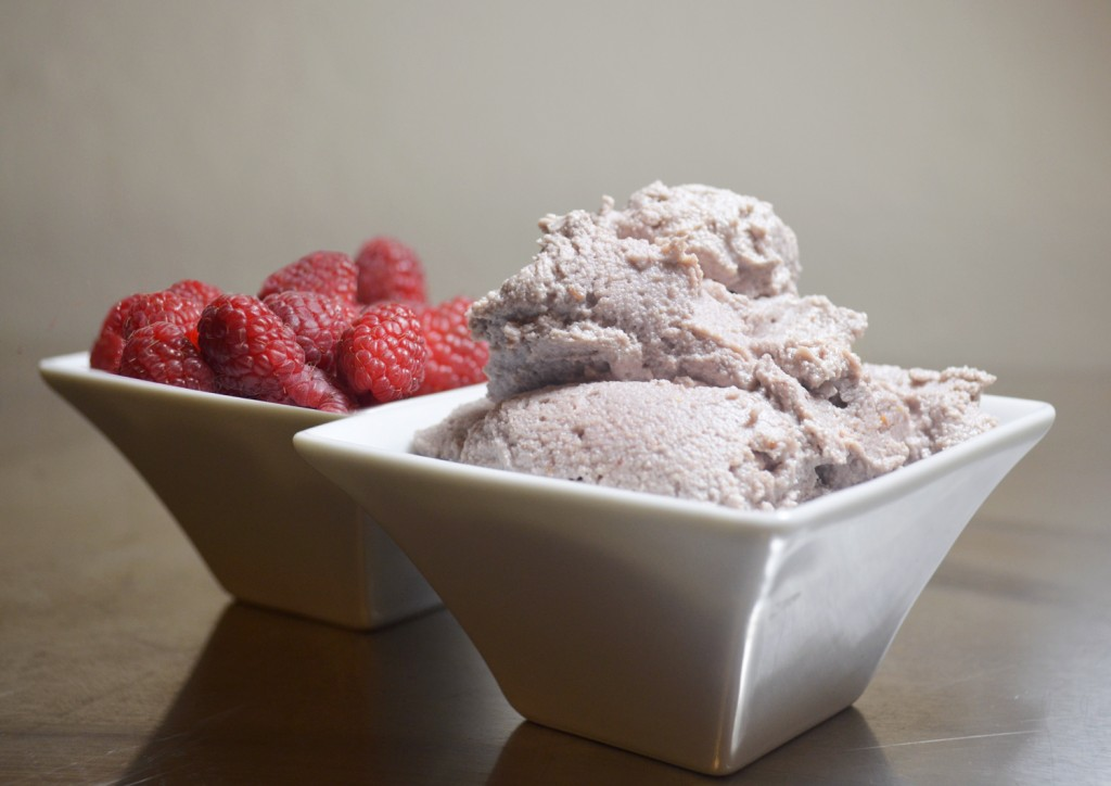 filling cream and rasberries presented in a bowl